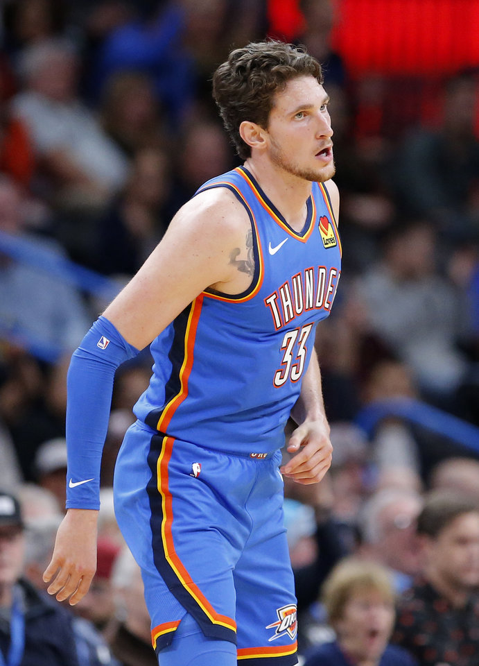 Photo - Oklahoma City's Mike Muscala (33) reacts after a 3-point basket during the NBA game between the Oklahoma City Thunder and the Golden State Warriors at Chesapeake Energy Arena,   Saturday, Nov. 9, 2019.  [Sarah Phipps/The Oklahoman]