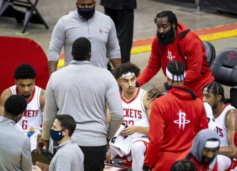Photo -  Houston Rockets guard James Harden, top right, joins the huddle while talking to guard Brodric Thomas (33) during the fourth quarter of a preseason game against the Spurs on Dec. 17 in Houston. [Mark Mulligan/Houston Chronicle via AP]