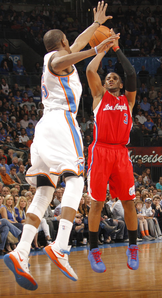 Photo - Los Angeles Clippers point guard Chris Paul (3) shoots over Oklahoma City Thunder small forward Kevin Durant (35) during the NBA basketball game between the Oklahoma City Thunder and the Los Angeles Clippers at Chesapeake Energy Arena on Wednesday, March 21, 2012 in Oklahoma City, Okla.  Photo by Chris Landsberger, The Oklahoman