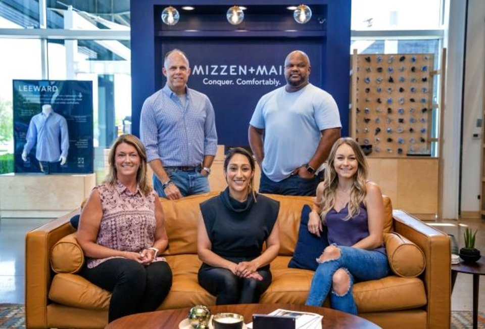 Photo -  Members of the Mizzen+Main team include, from left, Assistant Store Manager Cari Maxwell, CEO Chris Phillips, District Manager Rubina Azam, Design Director Gus Harris, and Store Manager Hayley Phillips pose for a photo in the new Mizzen+Main store located at 5820 N Classen in Classen Curve  on Wednesday [Chris Landsberger/The Oklahoman]