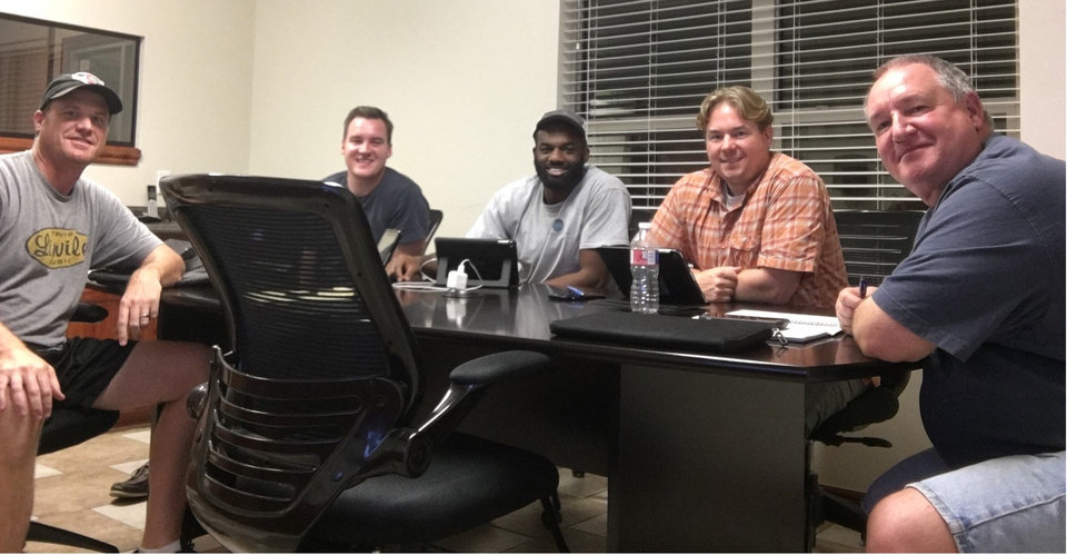 Photo -  Thomas Rossiter, second from right, is joined by Rusty LaForge, Tyler Holmes, Marcus Ude and Marc Weinmeister after purchasing Owl Court in February. [Photo provided]