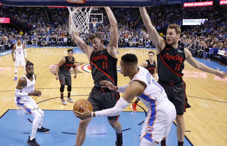 Photo - Oklahoma City's Russell Westbrook (0) passes the ball to Nerlens Noel as Meyers Leonard (11) and Portland's Jake Layman (10) defends during the NBA basketball game between the Oklahoma City Thunder and the Portland Trail Blazers at Chesapeake Energy Arena in Oklahoma City, Tuesday, Jan. 22, 2019. Photo by Sarah Phipps, The Oklahoman