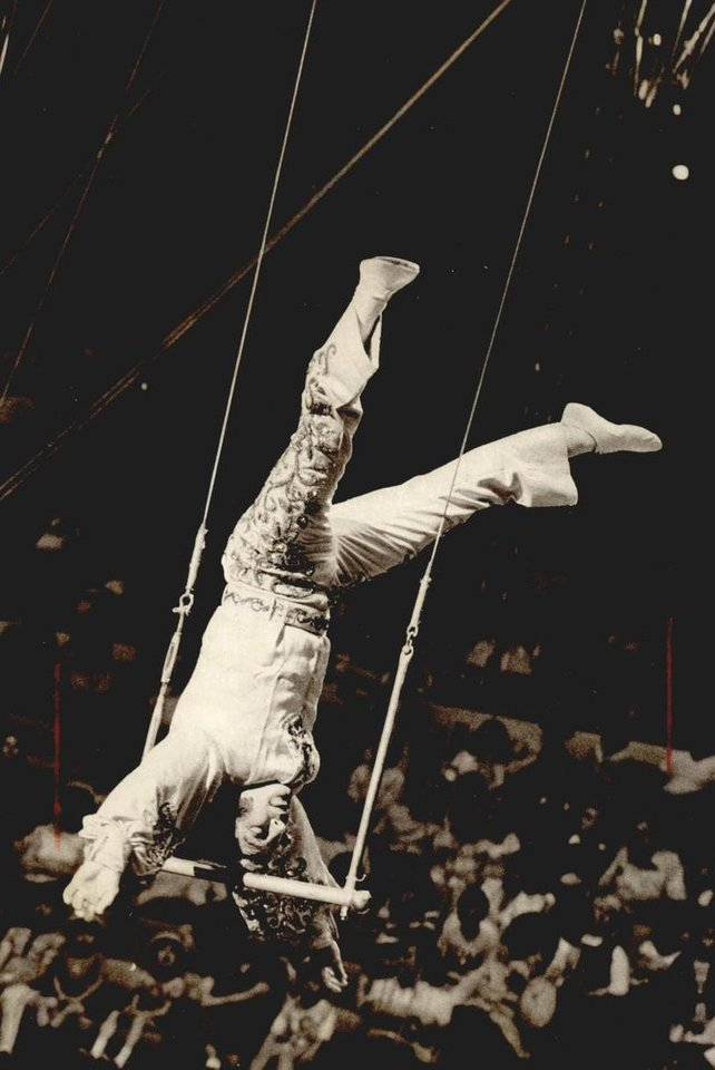 Photo - June 20, 1974: Thrilling the crowd at the Ringling Bros. and Barnum & Bailey Circus, the Great Balkanski balances on his trapeze. [Photo by Don Tullous, The Oklahoman Archives]