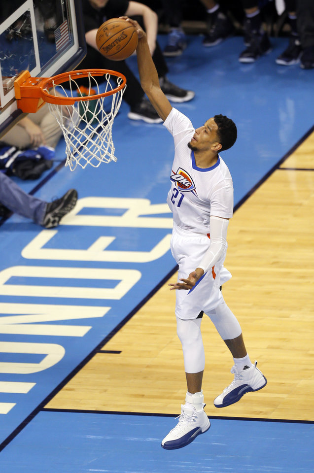 Photo - Oklahoma City's Andre Roberson (21) goes up for a dunk after a steal during Game 5 of the first round series between the Oklahoma City Thunder and the Dallas Mavericks in the NBA playoffs at Chesapeake Energy Arena in Oklahoma City, Monday, April 25, 2016. Photo by Sarah Phipps, The Oklahoman