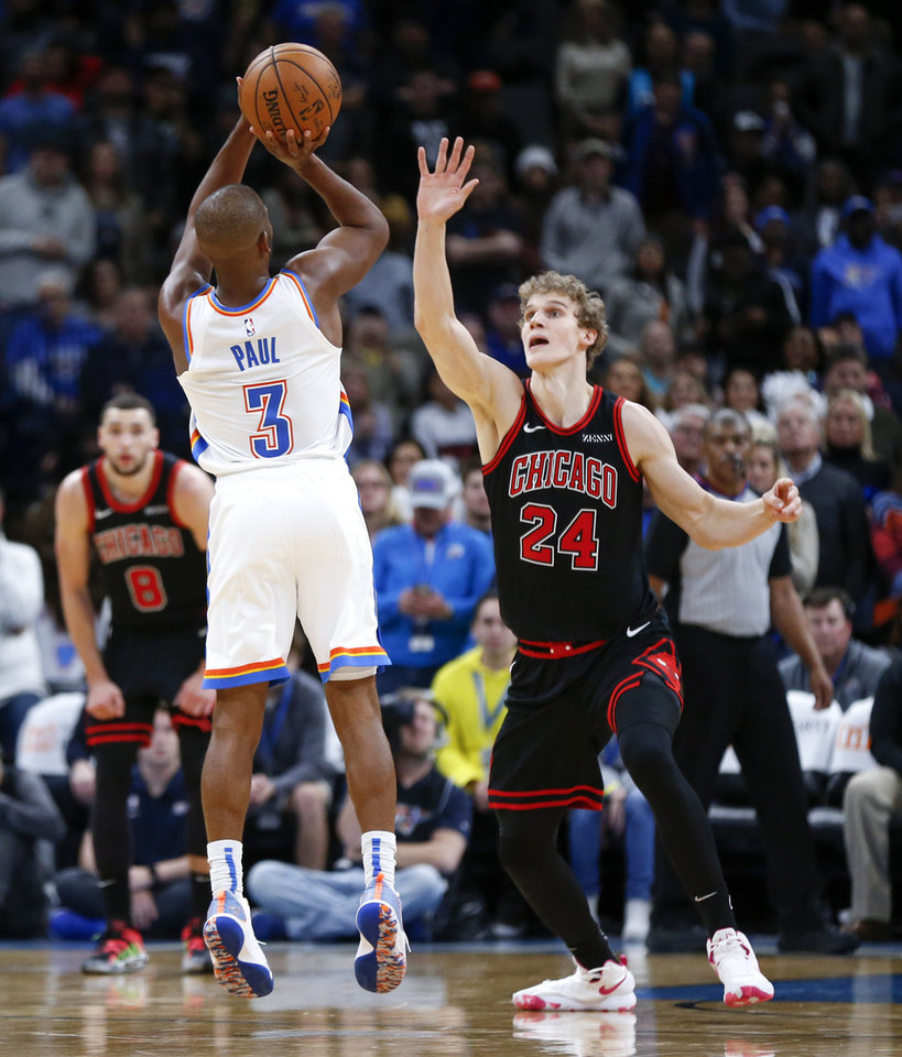 Photo - Oklahoma City's Chris Paul (3) takes and makes a three-point shot against Chicago's Lauri Markkanen (24) in the fourth quarter during an NBA basketball game between the Oklahoma City Thunder and Chicago Bulls at Chesapeake Energy Arena in Oklahoma City, Monday, Dec. 16, 2019. Oklahoma City won 109-106. [Nate Billings/The Oklahoman]