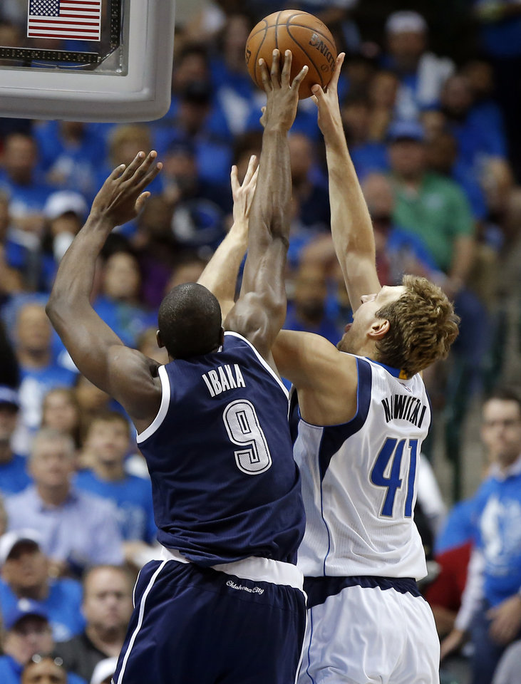 Photo - Oklahoma City's Serge Ibaka (9) blocks the shot of Dallas' Dirk Nowitzki (41) during Game 3 of the first round series between the Oklahoma City Thunder and the Dallas Mavericks in the NBA playoffs at American Airlines Center in Dallas, Thursday, April 21, 2016. The Thunder won 131-102. Photo by Bryan Terry, The Oklahoman