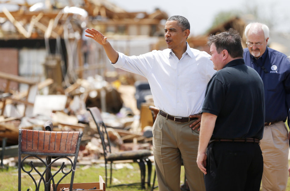Photo - President Barack Obama tours the Plaza Towers addition in Moore, Okla., beside Moore Mayor Glenn Lewis on Sunday, May 25, 2013. Photo by Bryan Terry The Oklahoman