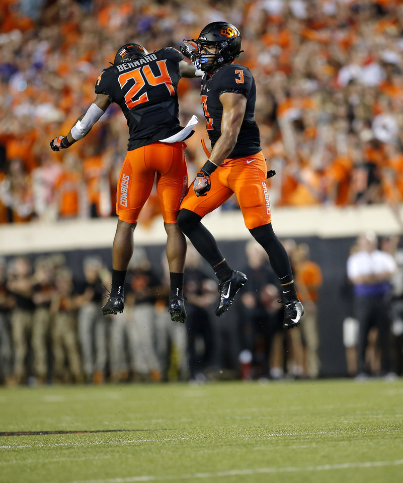 Photo - Oklahoma State's Tre Sterling (3) and Jarrick Bernard (24) celebrate a defensive play in the third quarter during the college football game between the Oklahoma State Cowboys and the Kansas State Wildcats at Boone Pickens Stadium in Stillwater, Okla., Saturday, Sept. 28, 2019. [Sarah Phipps/The Oklahoman]