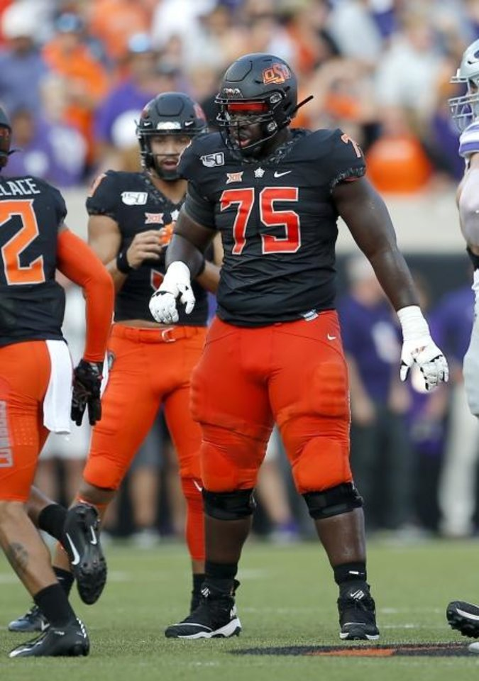 Photo -  Oklahoma State's Marcus Keyes prepares to line up against Kansas State on Saturday in Stillwater. The offensive line is performing well but can't afford any injuries. [Sarah Phipps/The Oklahoman]