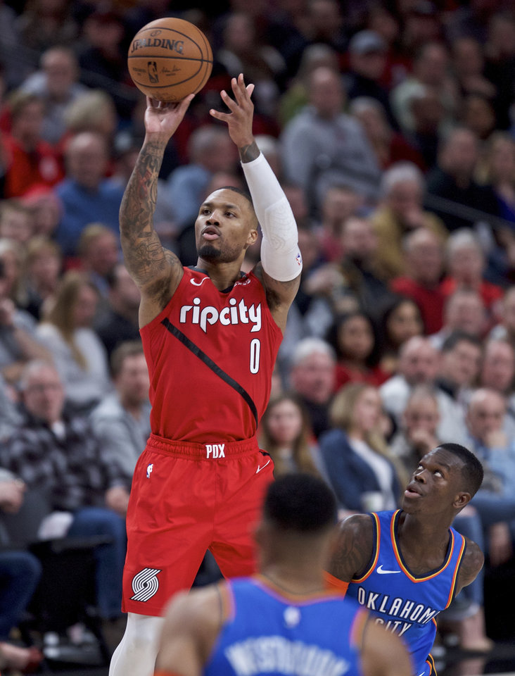 Photo - Portland Trail Blazers guard Damian Lillard shoots next to Oklahoma City Thunder guard Dennis Schroeder during the second half of an NBA basketball game in Portland, Ore., Friday, Jan. 4, 2019. (AP Photo/Craig Mitchelldyer)