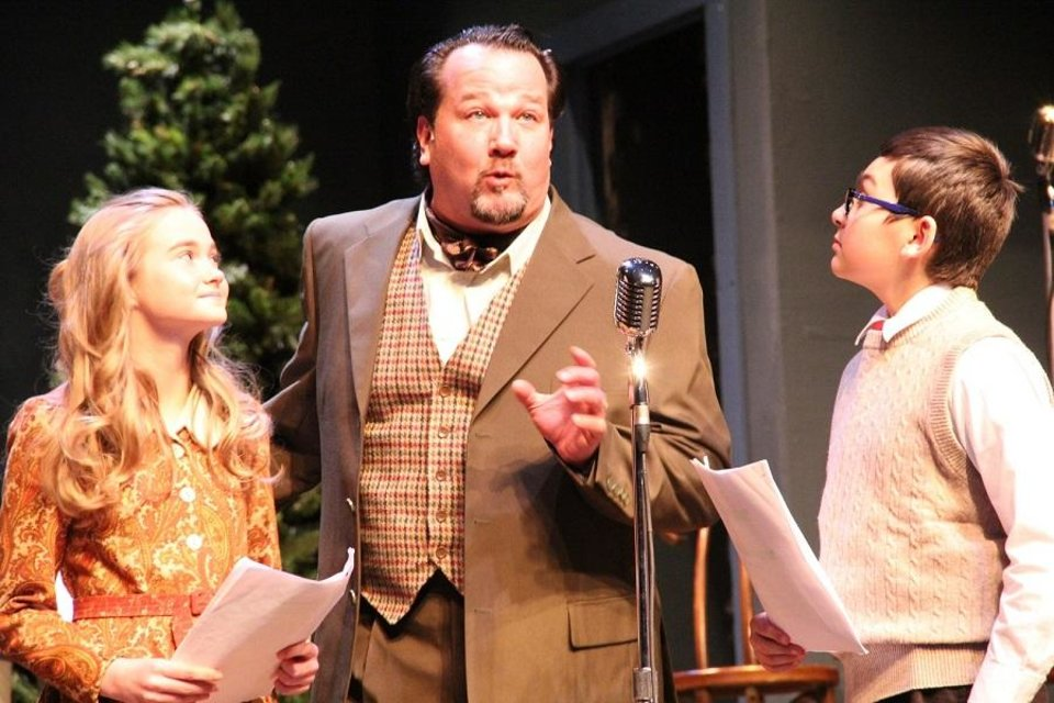 "Photo - From left, Ruth Daigle, Timothy Stewart, and Austin Barber appear in The Pollard Theatre's 2018 production of ""It's a Wonderful Life: A Live Radio Play"" at the historic downtown Guthrie theater. [Photo by Jennifer Jones]"