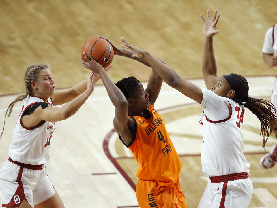 Photo - Oklahoma's Gabby Gregory (12) and Liz Scott (34) defend Oklahoma State's Natasha Mack (4) during a Bedlam women's college basketball game between the University of Oklahoma (OU) and Oklahoma State University (OSU) at Lloyd Noble Center in Norman, Okla., Tuesday, Dec. 15, 2020. [Bryan Terry/The Oklahoman]
