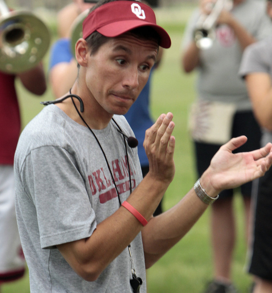 Photo - MARCHING BAND / PRACTICE: Band director Justin Stolarik rehearses The Pride of Oklahoma Band of the University of Oklahoma (OU) on Friday, Aug. 23, 2013 in Norman, Okla.  Photo by Steve Sisney, The Oklahoman
