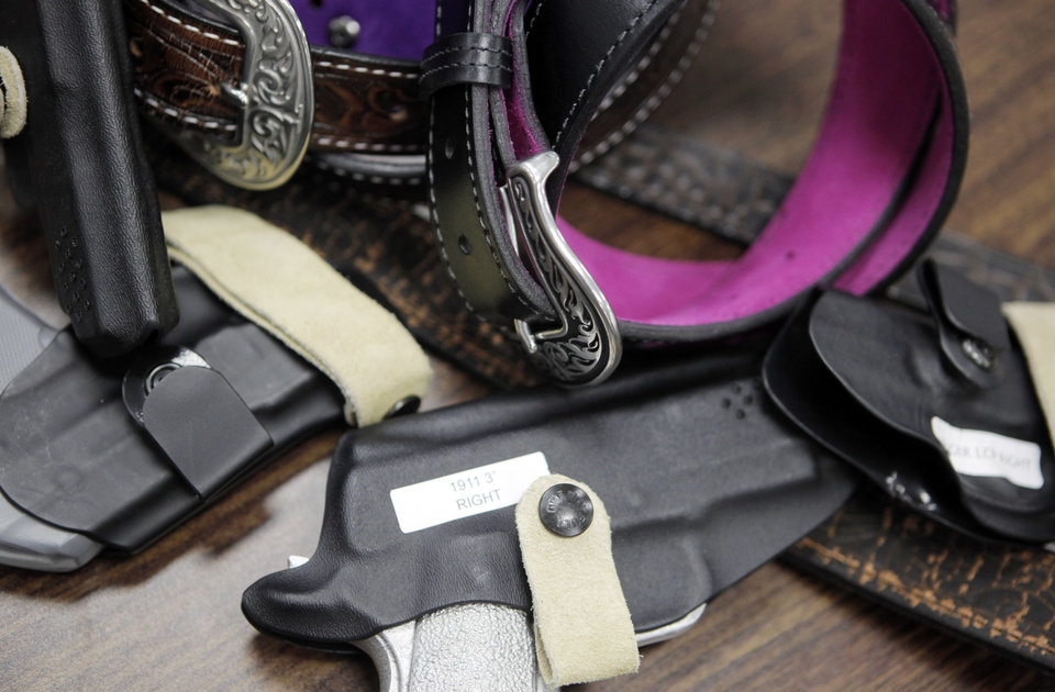 Photo - The Flashbang holster fits on the bra under a woman's bust line. Photo by KT King, The Oklahoman