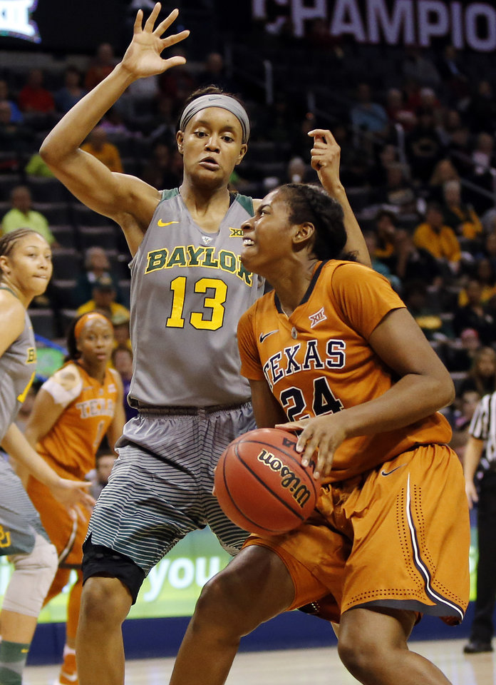 Photo - Texas' Ariel Atkins, right, tries to score against Baylor's Nina Davis during the Big 12 Women's Basketball Championship final at Chesapeake Energy Arena on Monday. (Photo by Nate Billings, The Oklahoman)