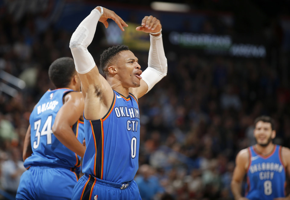 Photo -  Oklahoma City's Russell Westbrook celebrates during Saturday's basketball game between the Oklahoma City Thunder and the San Antonio Spurs at Chesapeake Energy Arena. The Thunder won, 104-94. [Photo by Bryan Terry, The Oklahoman]