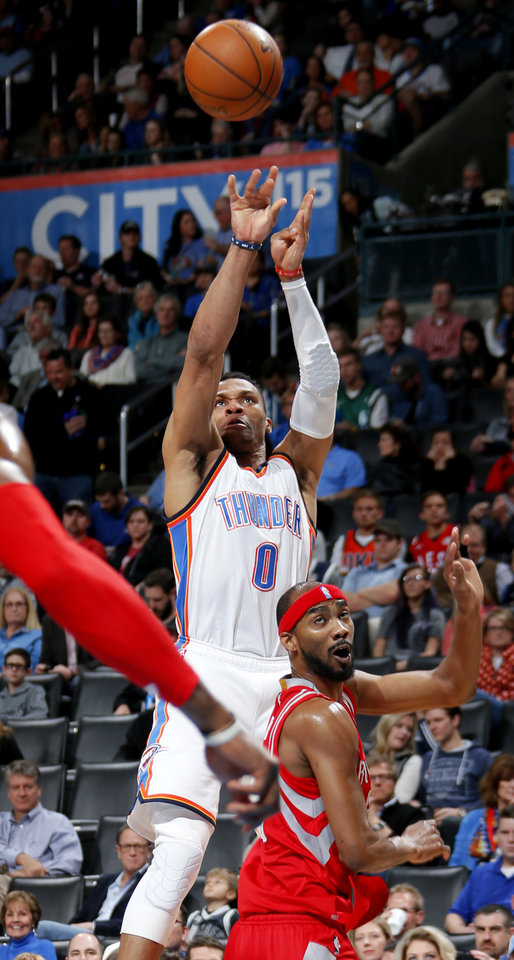 Photo - Oklahoma City's Russell Westbrook (0) shoots over Houston's Corey Brewer (33) during an NBA basketball game between the Oklahoma City Thunder and the Houston Rockets at Chesapeake Energy Arena in Oklahoma City, Friday, Jan. 29, 2016. Oklahoma City won 116-108. Photo by Bryan Terry, The Oklahoman