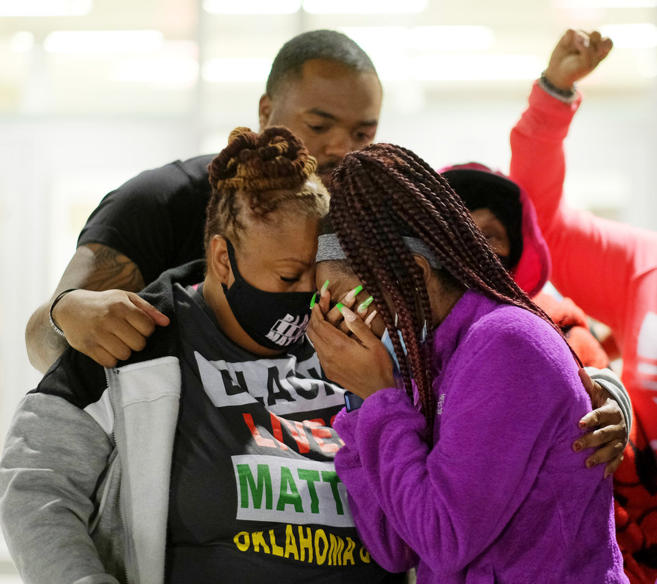 Photo - Rev. T. Sheri Dickerson and others comfort Ameera, the niece of Bennie Edwards, the man killed by police, after she spoke, as BLM holds a protest rally at the Oklahoma City Police Headquarters, then marched to the Oklahoma County Courthouse, then finally to the Oklahoma City Municipal Court Building Friday night in response to OCPD officers  shooting and killing a Black man in a northwest Oklahoma City parking lot at Penn and Hefner Friday morning, December 11, 2020. [Doug Hoke/The Oklahoman]