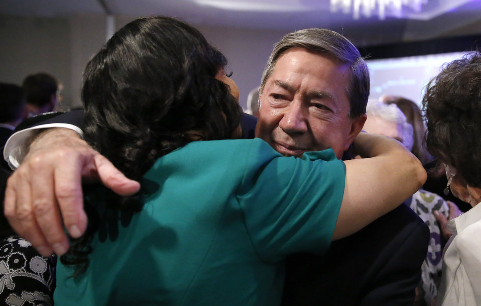Photo - Drew Edmondson hugs Anastasia Pittman following a concession speech after losing the governor's race to Republican Kevin Stitt during a watch party for Drew Edmondson and the democratic party at the Embassy Suites  in Oklahoma City, Tuesday, Nov. 6, 2018. Photo by Sarah Phipps, The Oklahoman