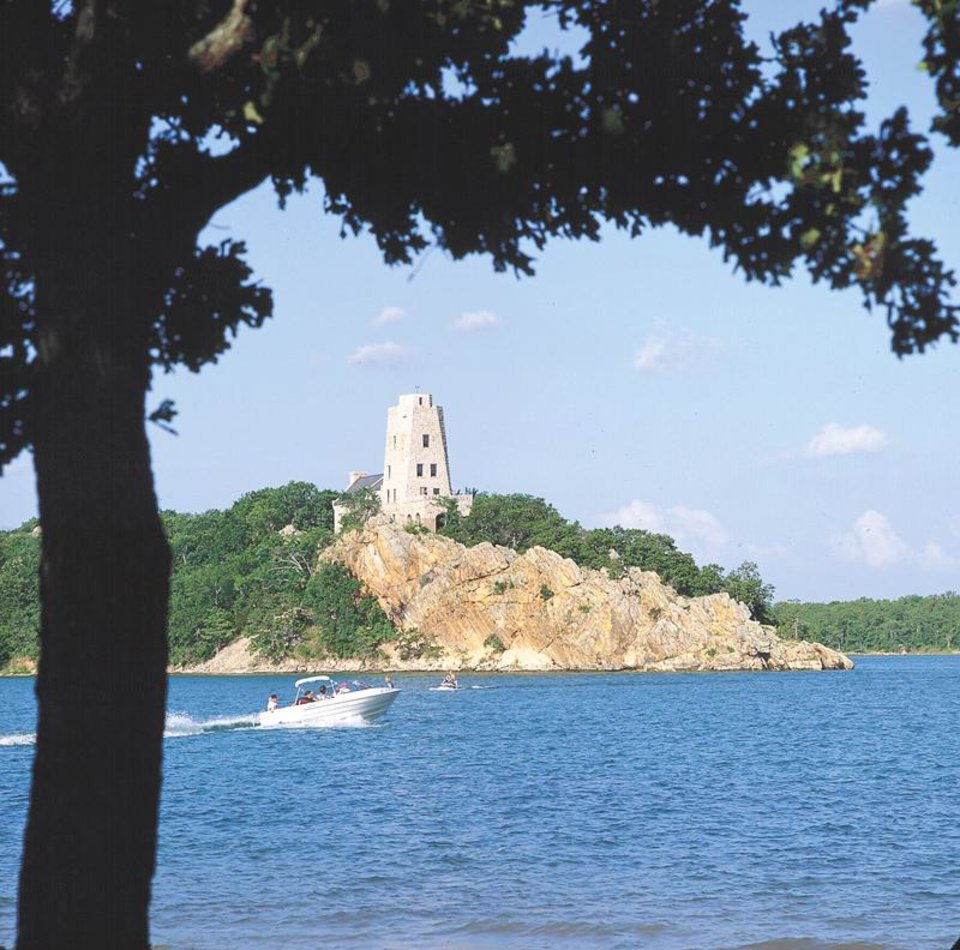 Photo - Tucker Tower stands proudly above Lake Murray as the most recognizeable feature at the southern Oklahoma recreational site. (OKLAHOMAN ARCHIVES)