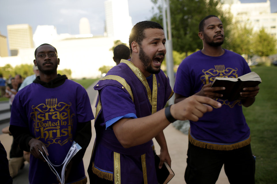 Photo - Israel United In Christ, who did not give individual names, protest a Black Mass at the Civic Center Music Hall, Sunday, Sept. 21, 2014.  Photo by Garett Fisbeck, For The Oklahoman