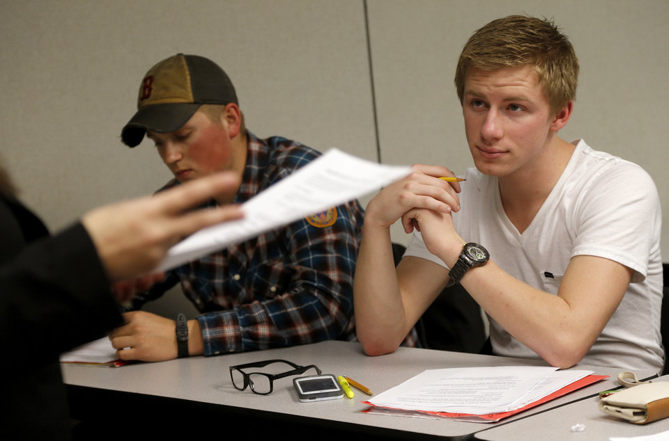 Photo - Jard Lavarnway, sophomore, at left, and freshman Zach Munzy listen during a Fundamentals of Speech hybrid course at The University of Central Oklahoma in Edmond, Wednesday, April 3, 2013. Photo by Bryan Terry, The Oklahoman