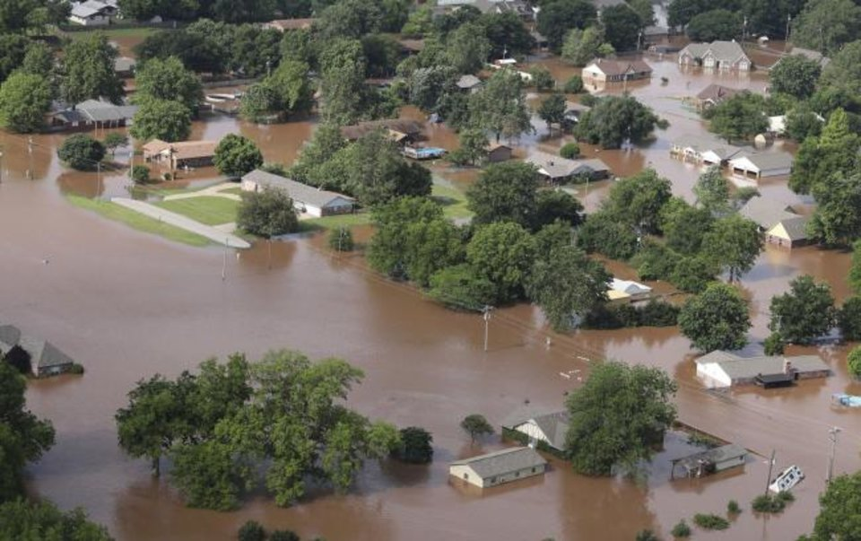 Photo - Homes are flooded near the Arkansas River in Tulsa, Okla., on Friday, May 24, 2019. The threat of potentially devastating flooding continued Friday along the Arkansas River from Tulsa into western Arkansas. (Tom Gilbert/Tulsa World via AP)