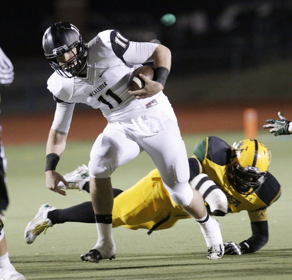 Photo - MHS #11 Dalton Wood runs into secondary during the high school football playoff between McAlester and Lawton MacArthur at Choctaw stadium, November 28, 2014. Photo by Doug Hoke, The Oklahoman