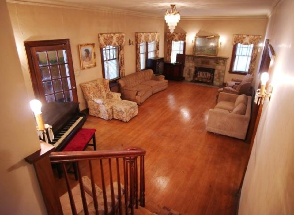 Photo -  The Luster Mansion's front room and living room are showen from the stairs.  [DOUG HOKE/THE OKLAHOMAN]