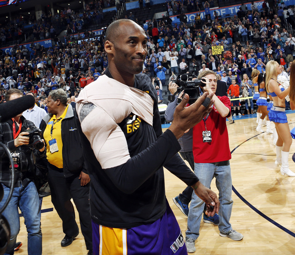 Photo - Los Angeles' Kobe Bryant (24) leaves the court after an NBA basketball game between the Oklahoma City Thunder and the Los Angeles Lakers at Chesapeake Energy Arena in Oklahoma City, Monday, April 11, 2016. This was the last road game of Bryant's career. Photo by Nate Billings, The Oklahoman