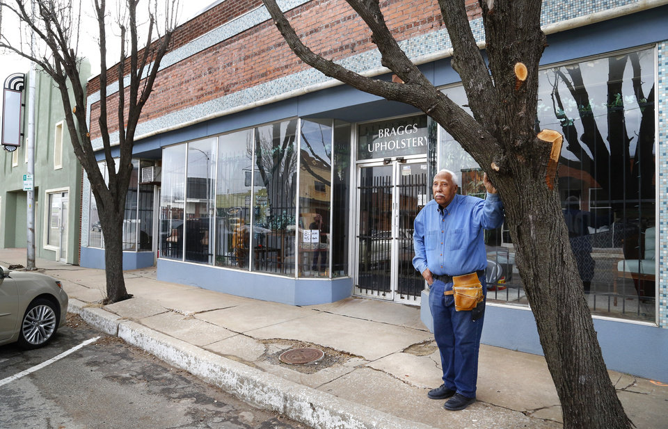 Photo - Odell Braggs in front of his upholstery business on Britton Rd. on Thursday, Feb. 21, 2019. The building once was a T.G.&Y store. Photo by Jim Beckel, The Oklahoman.
