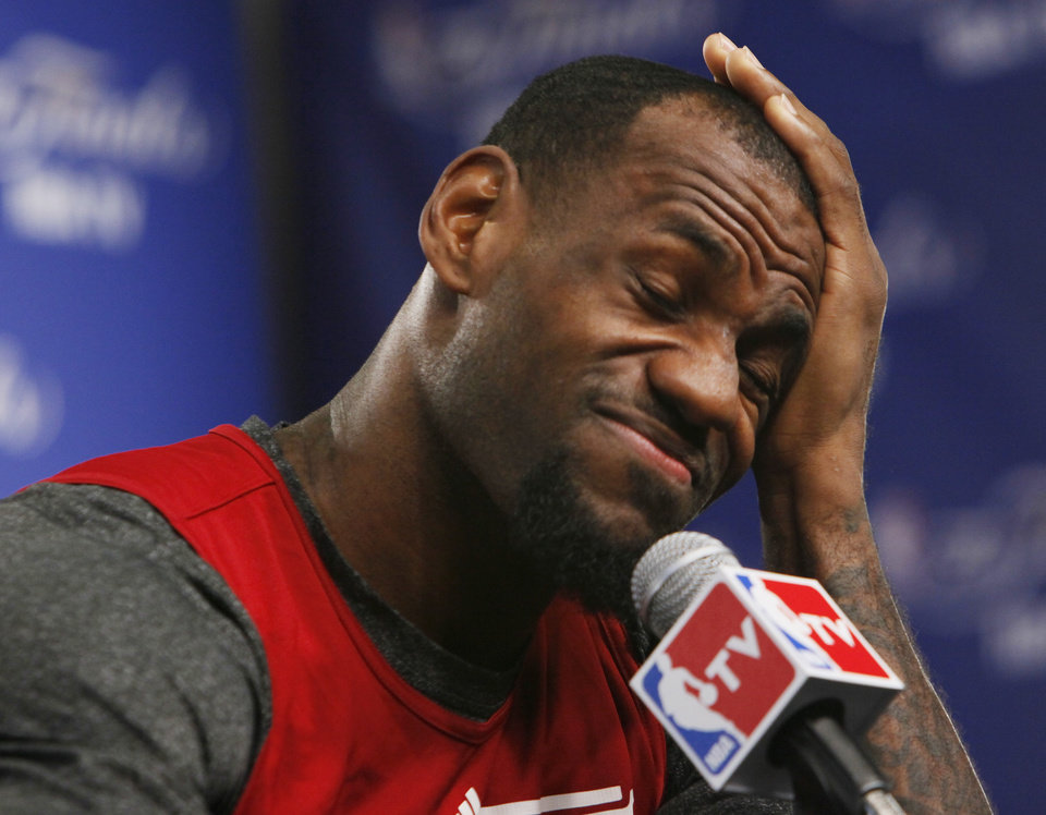 Photo - Miami's LeBron James rubs his head before answering questions during media and practice day for the NBA Finals between the Oklahoma City Thunder and the Miami Heat at the Chesapeake Energy Arena in Oklahoma City, Monday, June 11, 2012. Photo by Nate Billings, The Oklahoman
