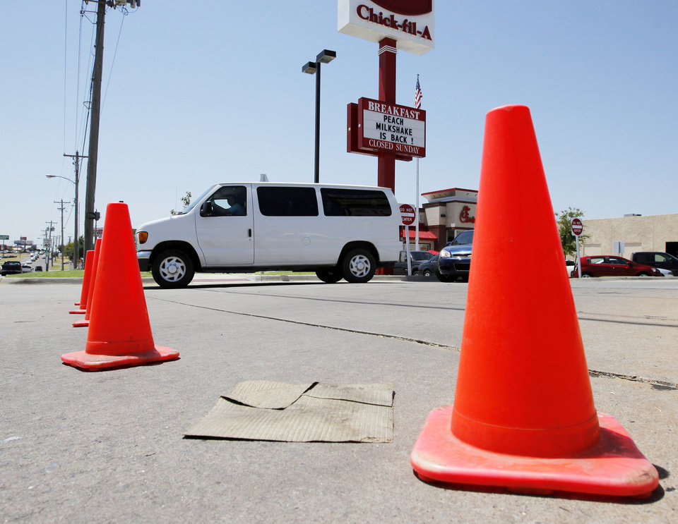 Photo - Traffic cones block entry from May Ave. to the parking lot of the Chick-fil-A at 6201 N May to prevent traffic from backing up into the intersection of NW 63rd and May at lunchtime during Chick-fil-A Appreciation Day in Oklahoma City, Wednesday, Aug. 1, 2012. Photo by Nate Billings, The Oklahoman
