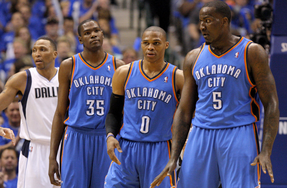 Photo - Oklahoma City's Kevin Durant (35), Russell Westbrook (0), and  Kendrick Perkins (5) reacts uring game 1 of the Western Conference Finals in the NBA basketball playoffs between the Dallas Mavericks and the Oklahoma City Thunder at American Airlines Center in Dallas, Tuesday, May 17, 2011. Photo by Bryan Terry, The Oklahoman