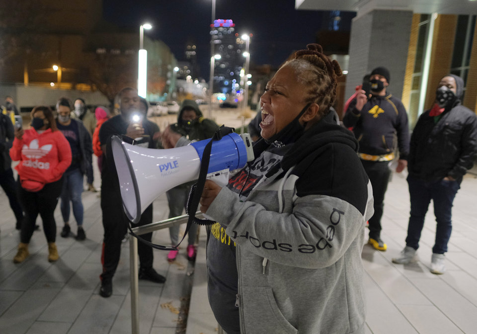Photo - Black Lives Matter OKC Executive Director Rev. T. Sheri Dickerson speaks, as BLM holds a protest rally at the Oklahoma City Police Headquarters, then marched to the Oklahoma County Courthouse, then finally to the Oklahoma City Municipal Court Building Friday night in response to OCPD officers  shooting and killing a Black man in a northwest Oklahoma City parking lot at Penn and Hefner Friday morning, December 11, 2020. [Doug Hoke/The Oklahoman]