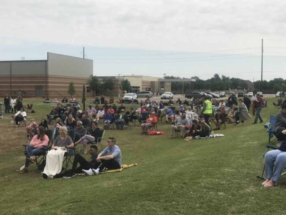 Photo -  People attend an outdoor service called