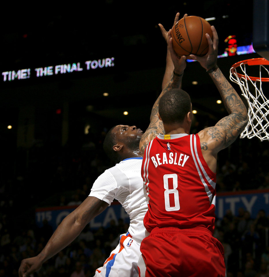 Photo - Oklahoma City's Dion Waiters (3) blocks the shot of Houston's Michael Beasley (8) during an NBA basketball game between the Oklahoma City Thunder and the Houston Rockets at Chesapeake Energy Arena in Oklahoma City, Tuesday, March 22, 2016. Oklahoma City won 111-107. Photo by Bryan Terry, The Oklahoman