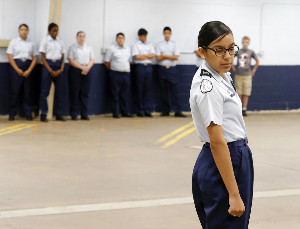 Photo -  Cadet Daisy Moreno, 16, a junior, leads the drill team during practice in the Crooked Oak High School Air Force JROTC building in Oklahoma City. [Photo by Nate Billings, The Oklahoman]
