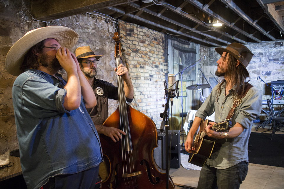 Photo -  From left, Buffalo Rogers, Ryan Houck and Dylan Stewart perform in the Brick Street Cafe basement in Okemah. [Photo by Nathan Poppe, The Oklahoman]