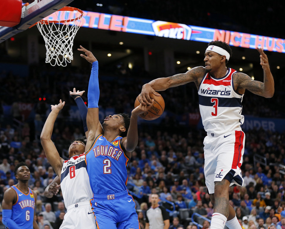 Photo - Washington's Bradley Beal (3) blocks a shot by Oklahoma City's Shai Gilgeous-Alexander (2) next to Washington's Rui Hachimura (8) in the second quarter during an NBA basketball game between the Oklahoma City Thunder and the Washington Wizards at Chesapeake Energy Arena in Oklahoma City, Friday, Oct. 25, 2019. [Nate Billings/The Oklahoman]