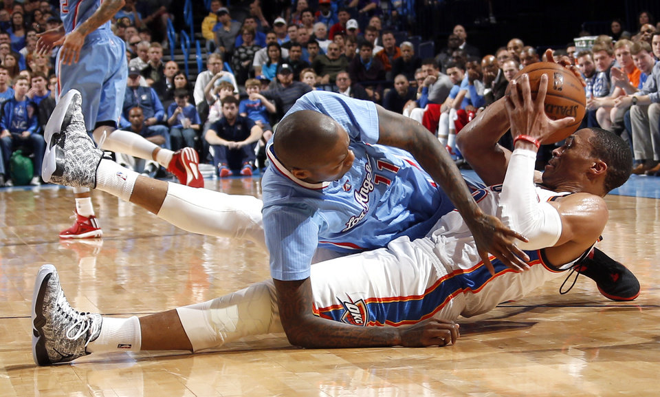 Photo - Oklahoma City's Russell Westbrook (0) and Los Angeles' Jamal Crawford (11) fight for a loose ball during the NBA basketball game between the Oklahoma City Thunder and the Los Angeles Clippers at the Chesapeake Energy Arena, Sunday, Feb. 8, 2015. Photo by Sarah Phipps, The Oklahoman