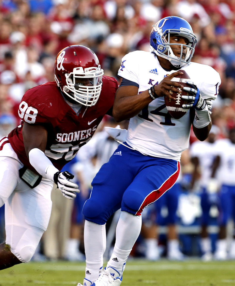 Photo - Oklahoma Sooners's Chuka Ndulue (98) sacks Michael Cummings during the college football game between the University of Oklahoma Sooners (OU) and the University of Kansas Jayhawks (KU) at Gaylord Family-Oklahoma Memorial Stadium in Norman, Okla., on Saturday, Oct. 20, 2012. Photo by Steve Sisney, The Oklahoman
