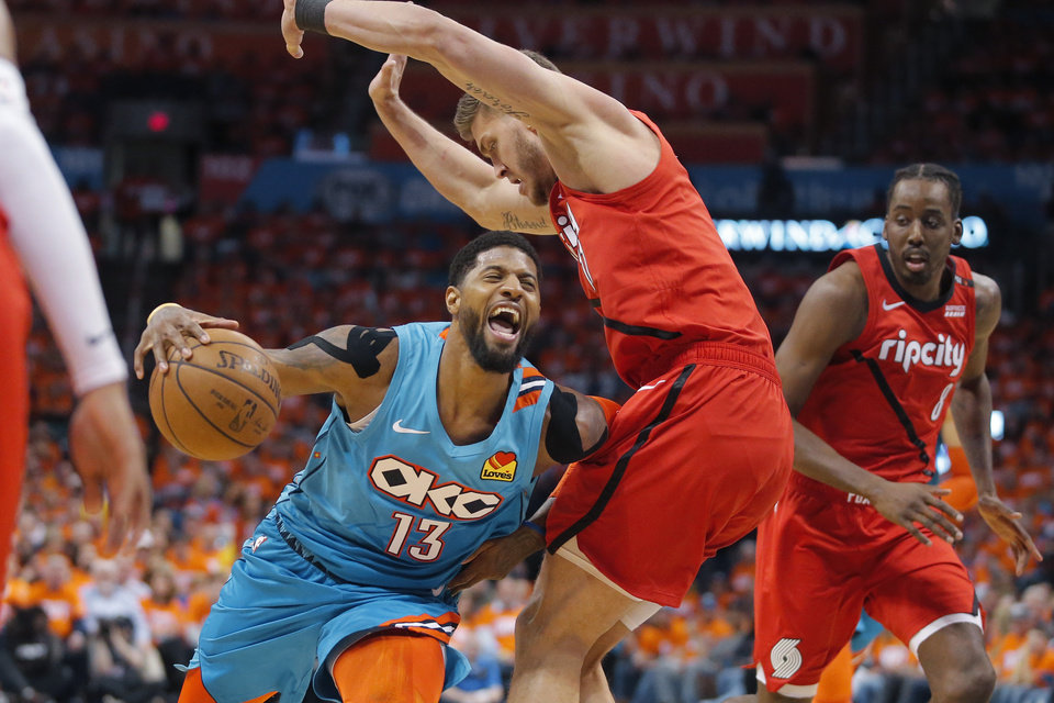 Photo - Oklahoma City's Paul George (13) is fouled by Portland's Meyers Leonard (11) during Game 3 in the first round of the NBA playoffs between the Portland Trail Blazers and the Oklahoma City Thunder at Chesapeake Energy Arena in Oklahoma City, Friday, April 19, 2019. Photo by Bryan Terry, The Oklahoman