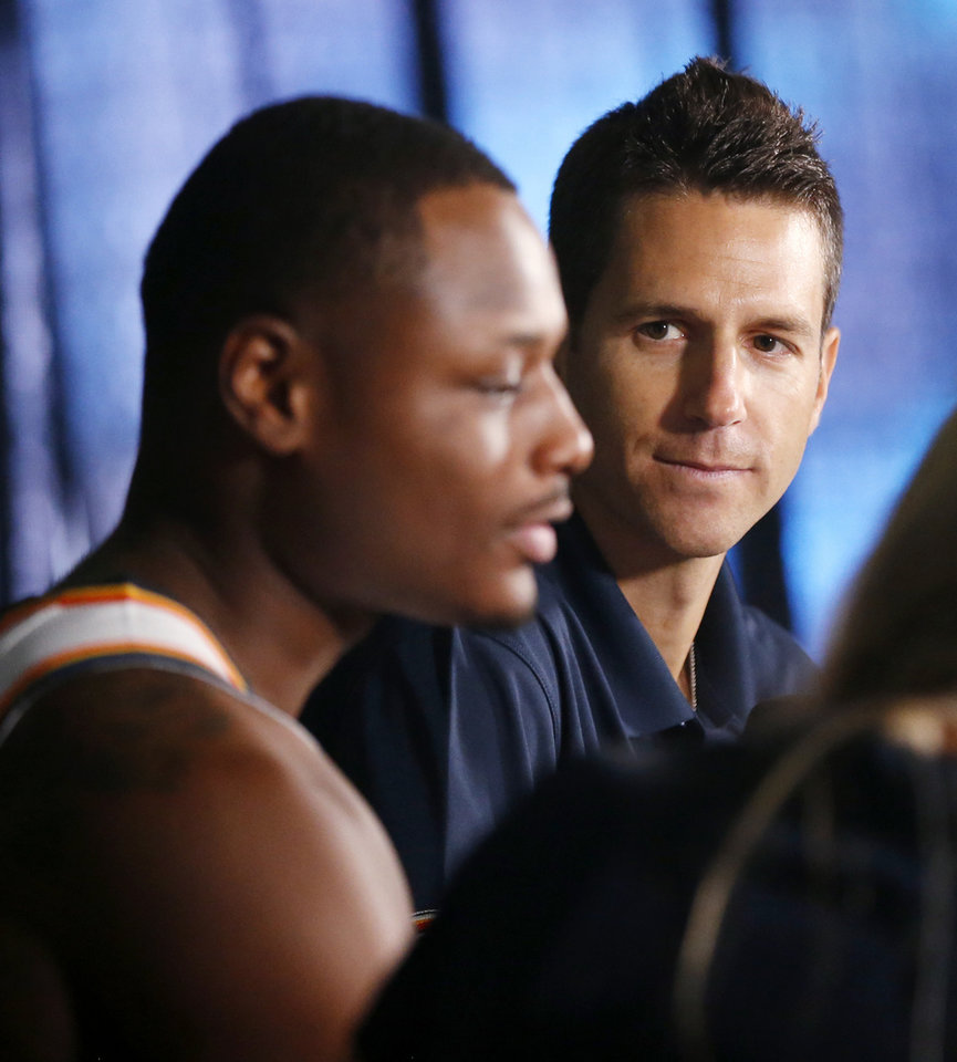 Photo - New Thunder television play-by-play announcer Chris Fisher listens during an interview with Deonte Burton at media day for the Oklahoma City Thunder at Chesapeake Energy Arena in Oklahoma City, Monday, Sept. 24, 2018. Photo by Nate Billings, The Oklahoman