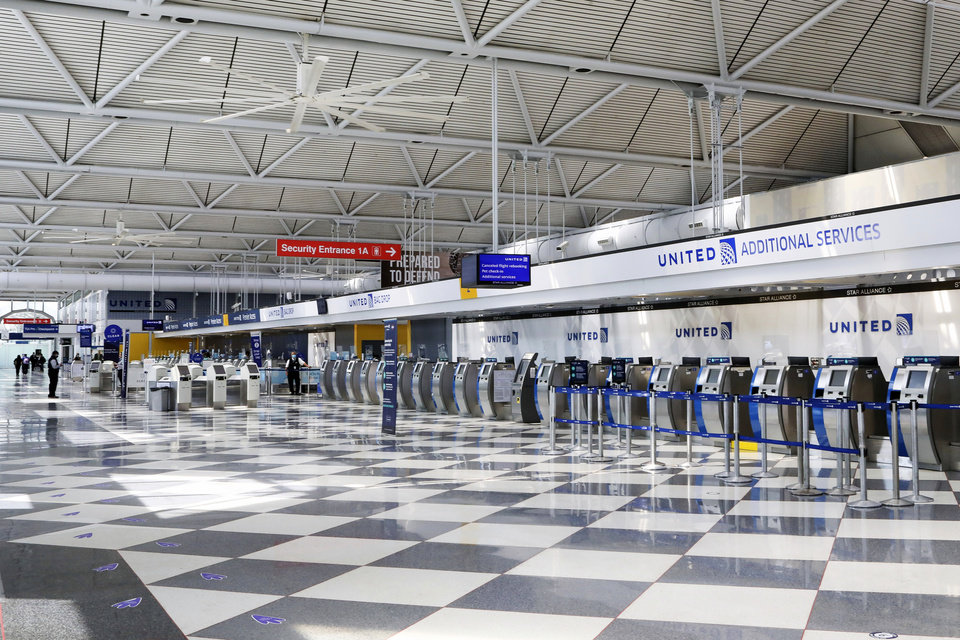 Photo -  Rows of United Airlines check-in counters at O'Hare International Airport in Chicago are unoccupied June 25 amid the coronavirus pandemic. [Teresa Crawford/Associated Press file photo]
