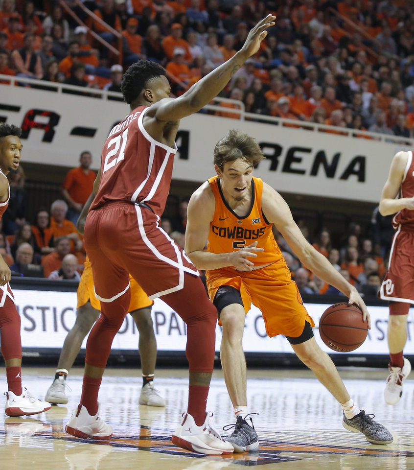 Photo -  Oklahoma State's Duncan Demuth tries to get past Oklahoma's Kristian Doolittle during Wednesday's Bedlam basketball game at Gallagher-Iba Arena in Stillwater. [Photo by Bryan Terry, The Oklahoman]