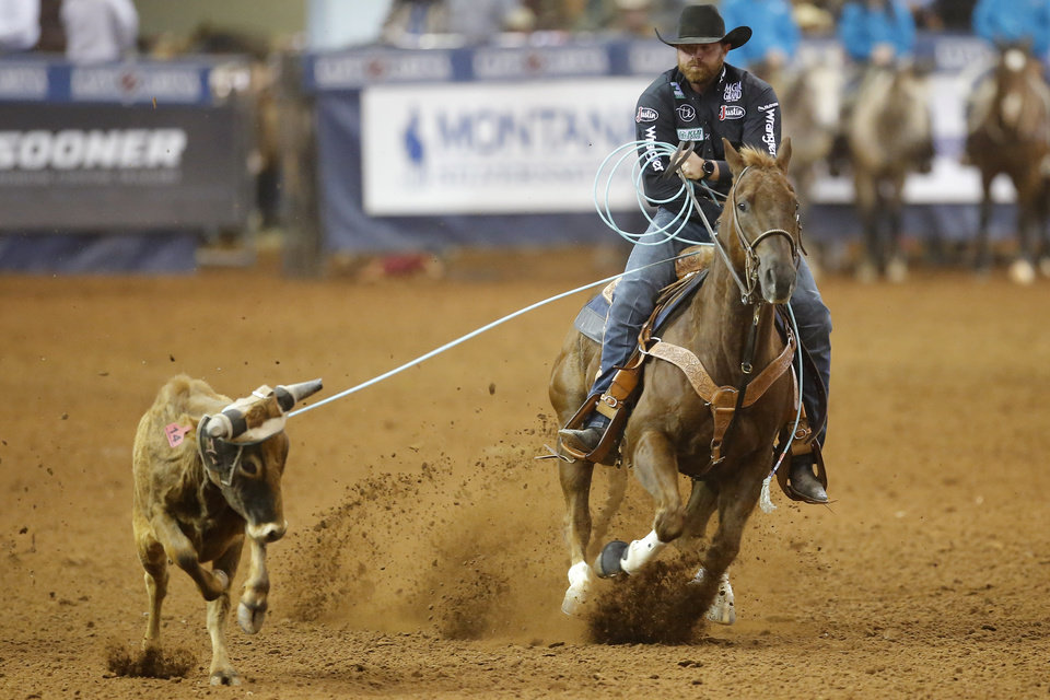 Photo - Clayton Hass of Weatherford, Texas,  competes in the heading event during the Timed Event Championship inside the Lazy E Arena in Guthrie, Okla., Friday, March 13, 2020. [Bryan Terry/The Oklahoman]