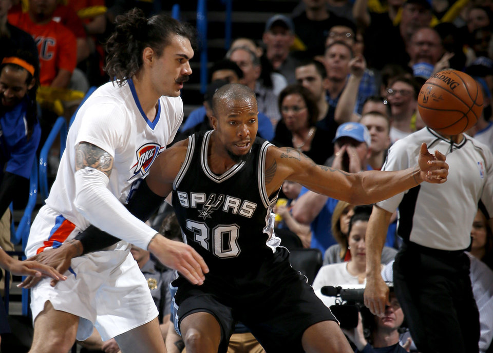 Photo - Oklahoma City's Steven Adams (12) defends San Antonio's David West (30) during an NBA basketball game between the Oklahoma City Thunder and the San Antonio Spurs at Chesapeake Energy Arena in Oklahoma City, Saturday, March 26, 2016. Oklahoma City won 11-92. Photo by Bryan Terry, The Oklahoman
