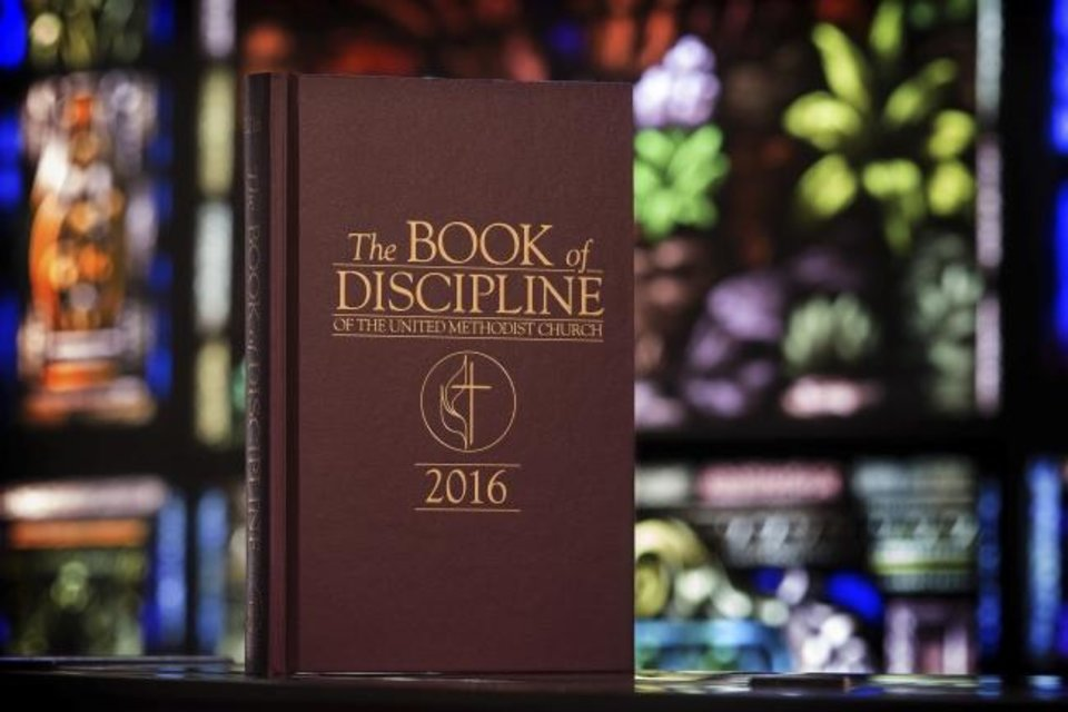 Photo -  This 2017 photo provided by United Methodist News Service shows the Book of Discipline which contains the rules that guide The United Methodist Church. The church convenes its top legislative assembly this weekend. [Mike DuBose/UMNS via AP]