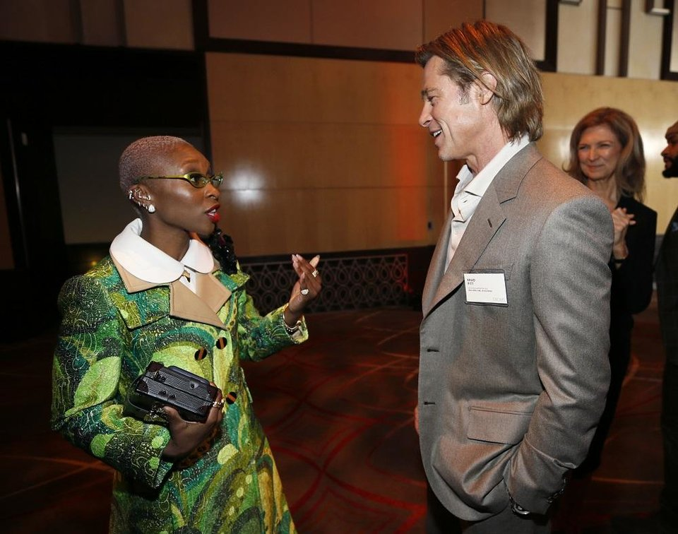 Photo - Cynthia Erivo, left, and Brad Pitt attend the 92nd Academy Awards Nominees Luncheon at the Loews Hotel on Monday, Jan. 27, 2020, in Los Angeles. [Photo by Danny Moloshok/Invision/AP]
